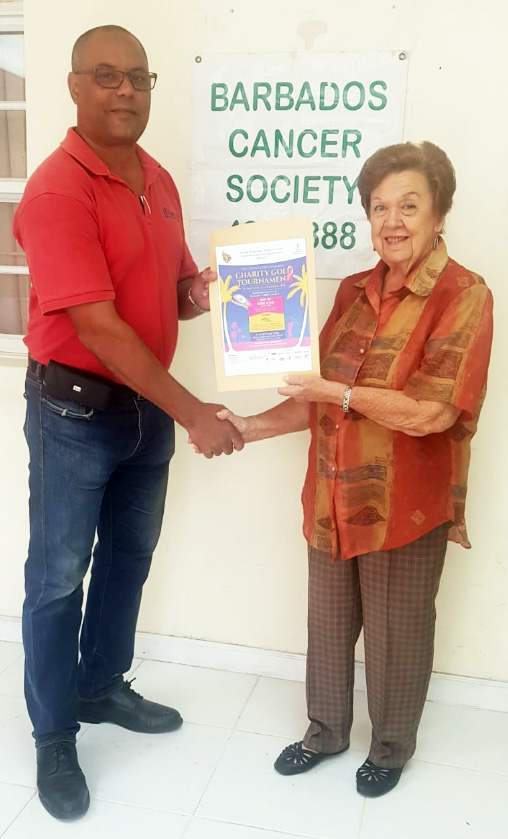 Manager of the RBW7s Local Organising Committee George Nicholson (left) presents the donation on behalf of RBW7s to President of the Barbados Cancer Society, Dr. Dorothy Cooke-Johnson.